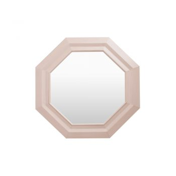 Un elegante espejo con marco octagonal color Rosa